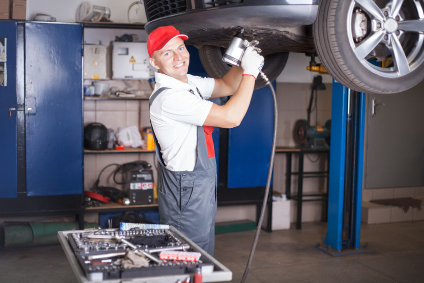 Mechanic screwing a tyre