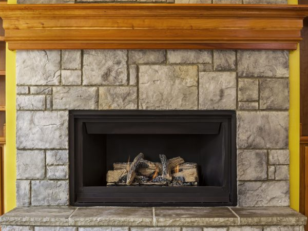 14015124 – natural gas insert fireplace built with stone and wood