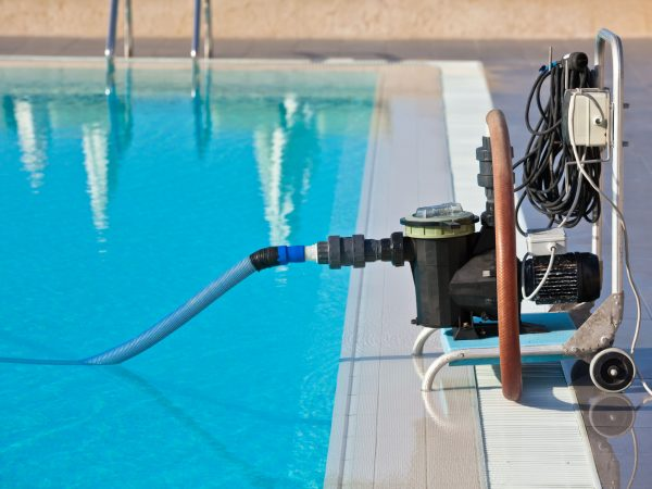 Cleaning pump working with a swimming pool. Horizontal shot