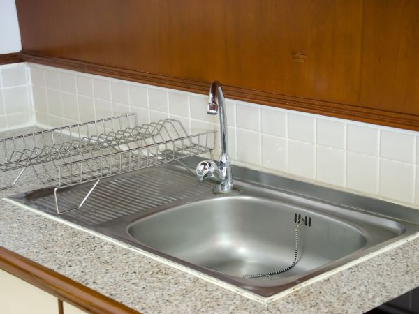 Modern kitchen sink for washing dishes.
