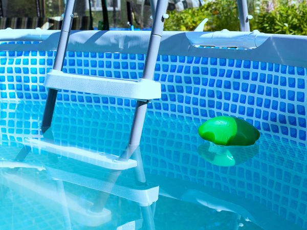 Swimming pool pipe technology. Country pool filtration. Portable small chlorine pool filter. Plastic starcase to country pool. Close-up.
