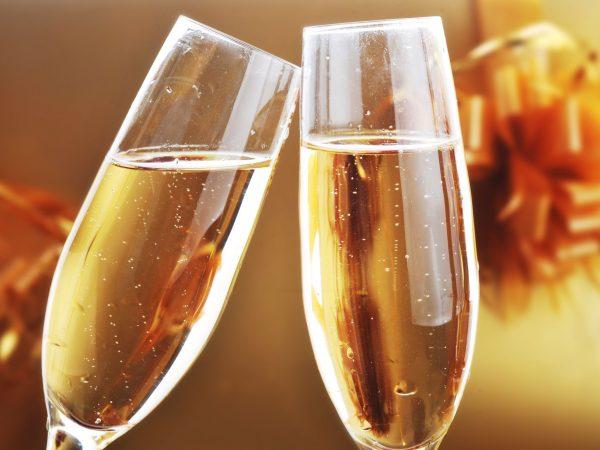 7756248 – two shampagne glasses on celebratory table