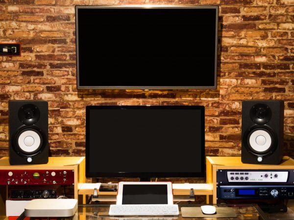 digital sound studio, music computer recording & editing equipment in loft design interior working space