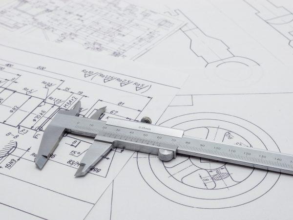 Vernier caliper lying on mechanical scheme.