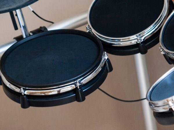 Electronic drum set closeup as musical background technology theme side view